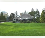 ARCHITECTURALLY DESIGNED AND SET ON ALMOST 2 ACRES